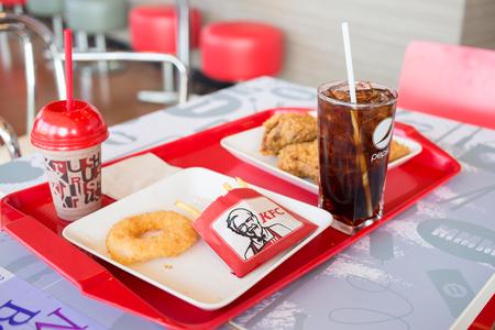 specializes: UdonThani ,THAILAND - FEBRUARY 6, 2016: Kentucky Fried Chicken (KFC) Restaurant Menu, KFC is a fast food restaurant chain that specializes in fried chicken