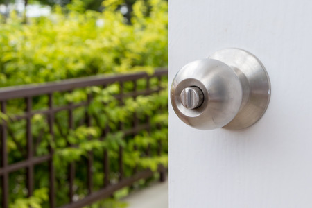 Close up of stainless steel round ball door knob Stock Photo