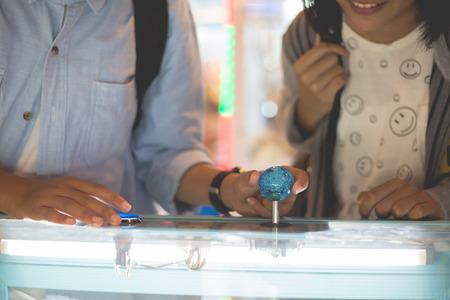 gameplay: Close up hand control joystick of arcade.