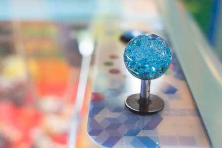 Close up of blue joystick control in the arcade. Stock Photo