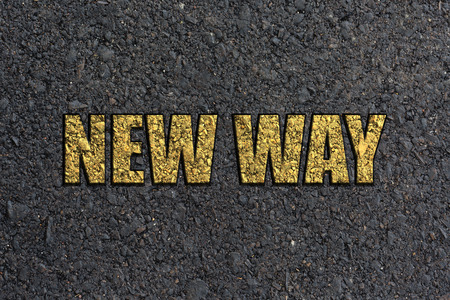new way: NEW WAY,Yellow paint line on the black road against asphalt background. Conceptual image Stock Photo