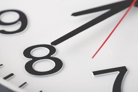 白い時計の顔のクローズ アップ マクロ。 写真素材
