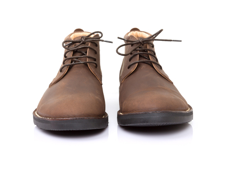 brogues: Brown suede leather shoes on white background.