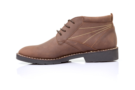 brogues: Brown suede leather shoe on white background.