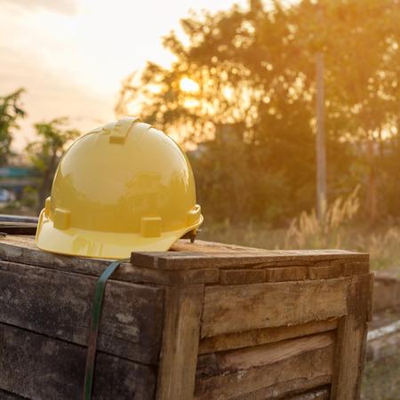 yellow helmet: Yellow helmet for engineering on wooden box.
