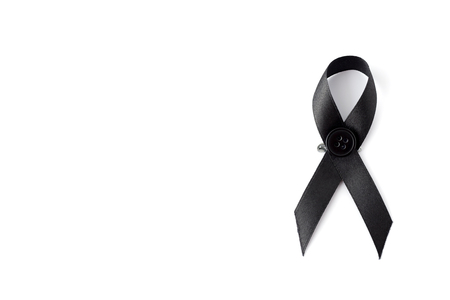 self harm: Black awareness ribbon with button on white background. Mourning and melanoma symbol. Stock Photo