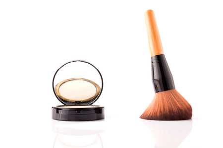 closeup of brush and face powder isolated on white background Stock Photo