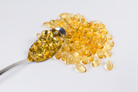 nutritional therapy: Omega 3 fish oil capsules on silver spoon Stock Photo