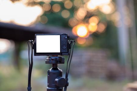 Soft focus camera on tripod Stock Photo