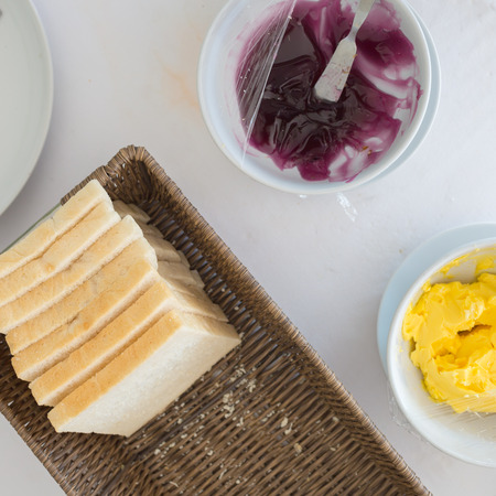 bread and butter: Top view of Food for breakfast consists of bread, butter and jam