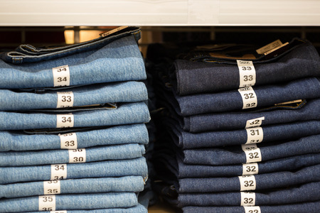 lable: Blue jeans denim Collection jeans stacked with lable size.