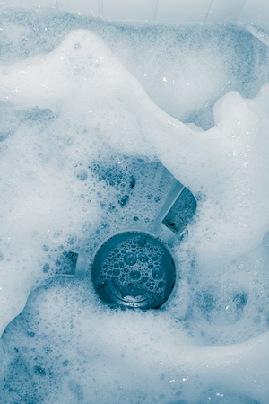 Bubble caused by washing as background Stock Photo