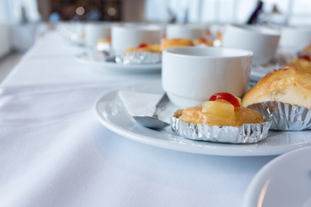 Close up coffee white cup and dessert prepare for breakfast in convention hall Stock Photo