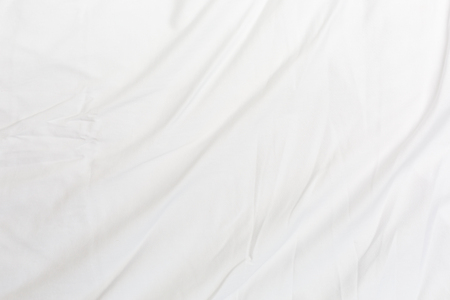 Top view of bedding sheets crease,white fabric texture