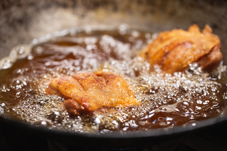 Fried chicken in hot oil and boiling in pan.