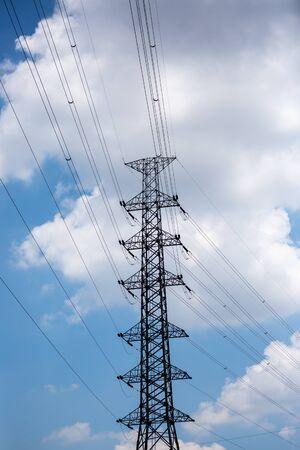 Electricity pylon on blue sky.