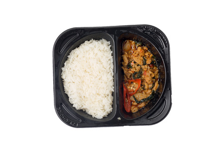 Isolated of stir-fried pork and basil in a package that can be microwave