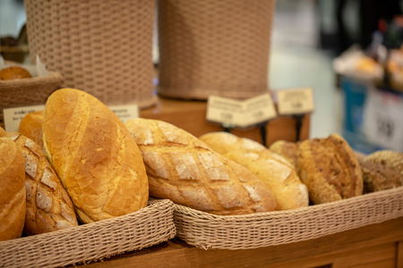 Variety of fresh bread in a supermarket.