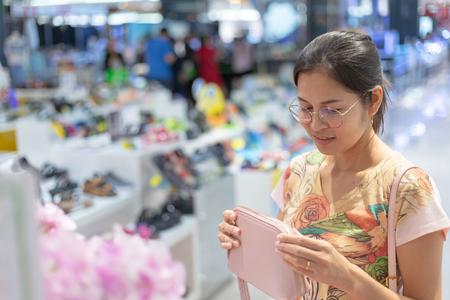 Asian women shop in department stores
