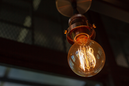 Close up of Illuminated light bulb with copy space
