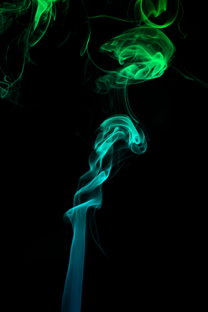 Abstract of colorful smoke on black background. 版權商用圖片