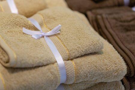 multi colored towels on the shelves. Banco de Imagens