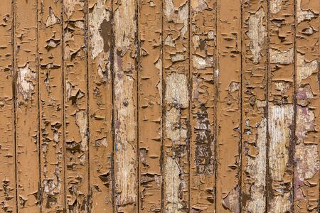 Cracked paint on a wooden surface,Brown cracked paint on wooden background.