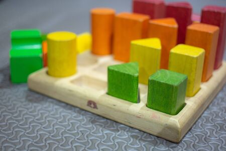 Wooden building blocks on table. Banco de Imagens