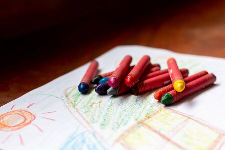 Colorful crayons placed on drawing paper. Stockfoto