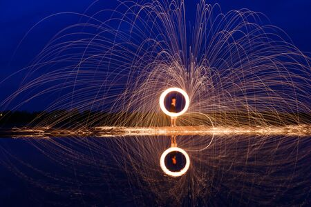 Lightpainting With Burning Steel Wool In The Night.