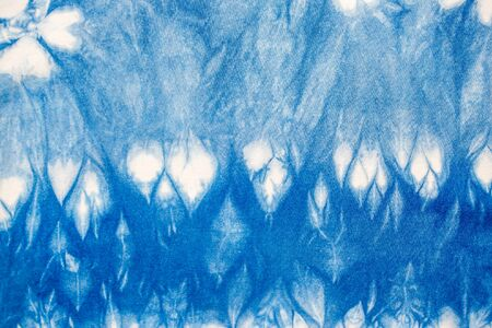 The fabric indigo tie dye as a background and texture