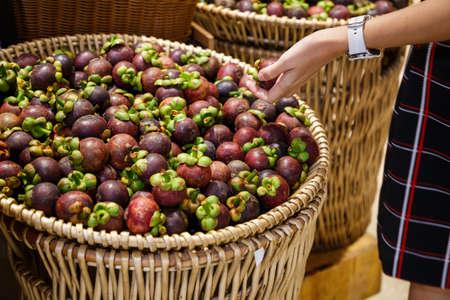 Fresh ripe mangosteen in basket