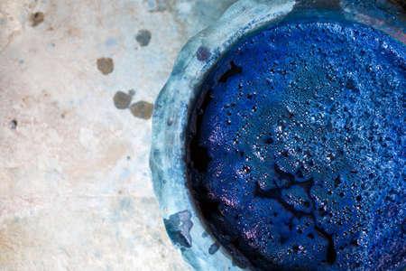 indigo color in clay pot for tie batik dyeing.