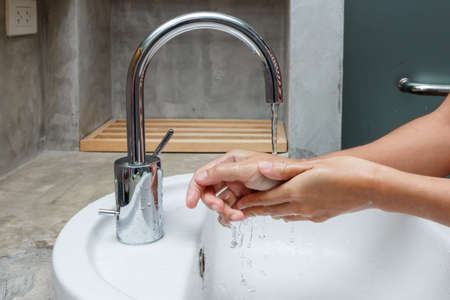 Woman washing hands under the water tap. Hygiene concept hand detail Banco de Imagens