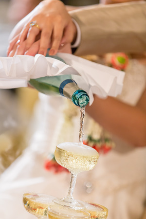 potation: pouring champagne in wedding ceremony Stock Photo