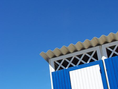 An unusal view of a beach cabin