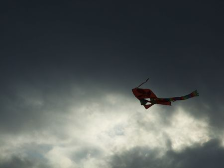 A brave kite flying in the middle of the storm photo