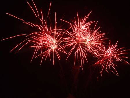 A trio of red fireworks
