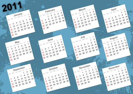 Full 2011 calendar on blue wall hit by paint blots Stock Photo - 7389521