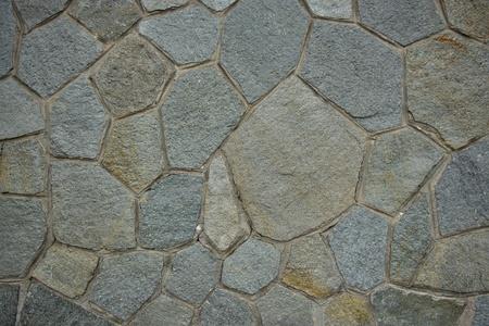 Wall made of irregular stone Stock Photo