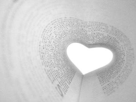 A book card arranged in the shape of a heart