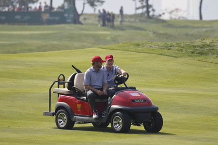 United States Team player JB Holms and Jim Furyk practice playing on the 9th green during the Presidents Cup Preperation First Day at Jack Nicklaus GC media center in Songdo.