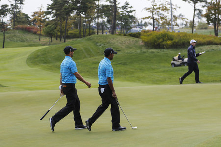 pga: International Team Player Adam Scott and Anirvan Lahiri pass on the 3th hall complete during the PGA Presidents Cup Mix Match at Jack Nicklaus GC in Incheon, South Korea.