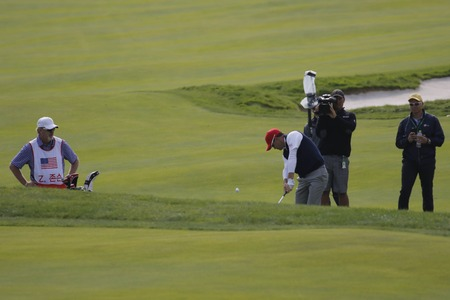 jack of clubs: United States Team Player Zach Johnson action on the 3th fairway during the PGA Presidents Cup Mix Match at Jack Nicklaus GC in Incheon, South Korea.