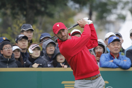 pga: United States Team Player Dustin Johnson action on the 4th tee during the PGA Tour President Cup Single Match at Jack Nicklaus GC in Incheon, South Korea.