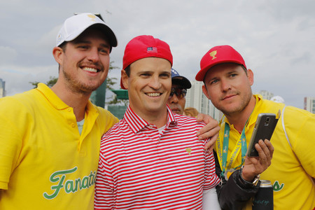 pga: United States Team player Zach Johnson take a picture with cheer mans after match finished on the 18th green during the PGA Tour President Cup Single Match at Jack Nicklaus GC in Incheon, South Korea. Editorial