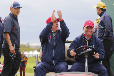pga: United States Team Captain Jay Haas win ceremony after match finished on the cart during the PGA Tour President Cup Single Match at Jack Nicklaus GC in Incheon, South Korea.