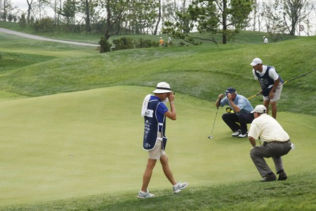 Russ Cochran of USA (R upper) and Scott Hoch of USA, check their 8th hall putting lines during the PGA Tour Songdo IBD championship second round at Jack Nicklaus golf club in Incheon, west of Seoul, on Sep 17, 2011, South Korea.