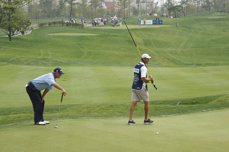 pga: Russ Cochran of USA, check his 8th hall putting line during the PGA Tour Songdo IBD championship second round at Jack Nicklaus golf club in Incheon, west of Seoul, on Sep 17, 2011, South Korea.