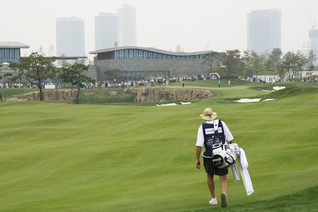 pga: Caddy of Mark Calcavecchia going to 9th hall during the PGA Tour Songdo IBD championship second round at Jack Nicklaus golf club in Incheon, west of Seoul, on Sep 17, 2011, South Korea.